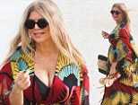 Pregnant Fergie reveals her growing curves in swimsuit and colourful kaftan as she hits the beach