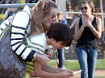 Doting parent: LeAnn Rimes took her stepsons to a little league baseball game in Los Angeles, on Thursday