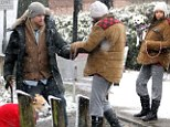 What a gentleman! Channing Tatum gives pregnant wife Jenna Dewan a helping hand on snowy London stroll