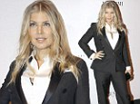 Suits you miss! Pregnant Fergie covers up her lovely baby bump in a chic black tuxedo and crisp white shirt as she attends amFAR event in Brazil