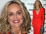 Did you do that in the dark? Sharon Stone gets heavy handed with the eyeshadow and lipstick at Brazilian red carpet event