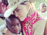 Family portrait? Madonna and Lourdes cuddle up to some Malawian orphans