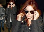Transformed! Megan Fox hops aboard the red-haired trend as she arrives at LAX with fiery tresses