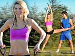 A hands on approach! Brandi Glanville beams with delight as she works out her incredibly toned figure with a handsome personal trainer