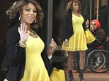 Tamar Braxton's sunny yellow dress displays the first signs of her baby bump