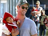 Thor blimey! Chris Hemsworth puts his muscles to good use as he carries baby India during outing with wife Elsa