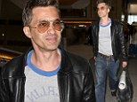 Keeping his cool: Olivier Martinez stays calm as he jets out of same airport where he lashed out at photographer