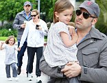 Daddy's girl! Little Seraphina gets a cuddle from father Ben Affleck during day out with mother Jennifer Garner and sister Violet