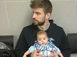 Father and son: Gerard Pique and his 10-week-old son Milan at the passport office