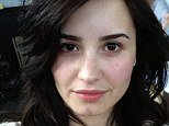 Fresh-faced: Demi Lovato tweeted a makeup free snap, encouraging her fans to do the same, on Wednesday