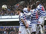 Dodgy defending: Adel Taarabt (second left) shies away from Shaun Maloney's free-kick