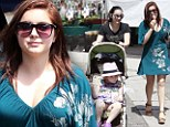 Happy family! Ariel Winter indulges in her favourite icy treat during regular farmer's market outing with sister and nieces