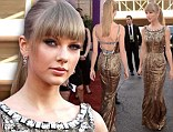 Hot metal! Stunning Taylor Swift steals the red carpet show in a shimmering old gold gown at the Academy of Country Music Awards