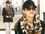 Now that's how you wear a tracksuit! AnnaLynne McCord gives her casual outfit a chic twist as she jets into JFK