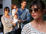 Swinging good time: Kourtney Kardashian and Scott Disick take their children to Malibu playground