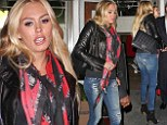 New mother Petra Ecclestone continues to put her post-pregnancy figure on display as she slips into a pair of skinny jeans