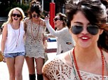 Ready for your close-up! Friend takes candid snap of Selena Gomez as she enjoys day out with girlfriends in California