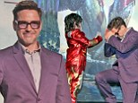 Bow in the presence of greatness: Robert Downey Jr. falls to his knees as he meets a mini Iron Man during Beijing premiere