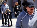 Aren't you a little old for that? Christian Bale spends family day with wife and daughter gliding around on scooters