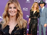 Faith Hill beams a bright smile as she flashes her clear braces at the ACM Awards... just two months after debuting the headgear