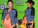 A kiss for her future sister or brother! Ali Landry's daughter Estela plants a smooch on her growing baby bump at charity event