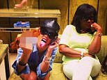 Naughty by nature: Rihanna swears at the camera as she shoe shops with her mother Monica Braithwaite on Friday