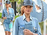 Double denim drama! Rihanna reveals her rear end in a ripped jean skirt