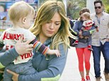 Doting mother: Hilary Duff hip-carried her son Luca as her husband former hockey player Mike Comrie followed close behind in Hollywood, on Saturday