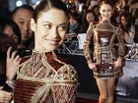 Actress Olga Kurylenko poses on the red carpet as she arrives for the premiere of Oblivion