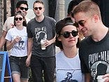 What relationship issues? Robert Pattinson and Kristen Stewart put on a rare show of public affection as they take a touchy feely stroll