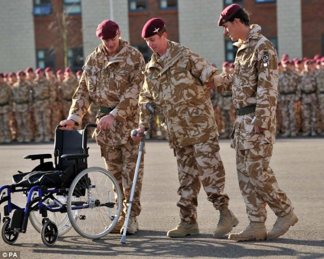 Strong: Cpl Tom Neathway stands to receive a medal from the Prince of Wales at the Parachute Regiment's base in Colchester, Essex in 2008