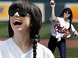 Hit this ball, maybe? Singer Carly Rae Jepsen shows off her sporty side by throwing the ceremonial first pitch at baseball game