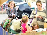 My little pony! Jennifer Garner's daughter Seraphina catches a ride on her own magical pinto at the Farmers' Market