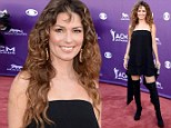 That don't impress us much! Shania Twain dons a layered bandeau black dress with thigh-high boots at Academy of Country Music Awards