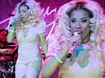 Sheer daring! Controversial Keyshia Cole bares her curves in a sexy cut-out jumpsuit as she performs during her sold-out tour