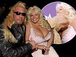 Don't get lost in there! Dog The Bounty Hunter buries his head in wife Beth's ample bosom as pair attend the ACM awards