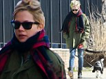 Does this mean she's missing you, Jason? Downcast Michelle Williams goes for lonely walk with her dog