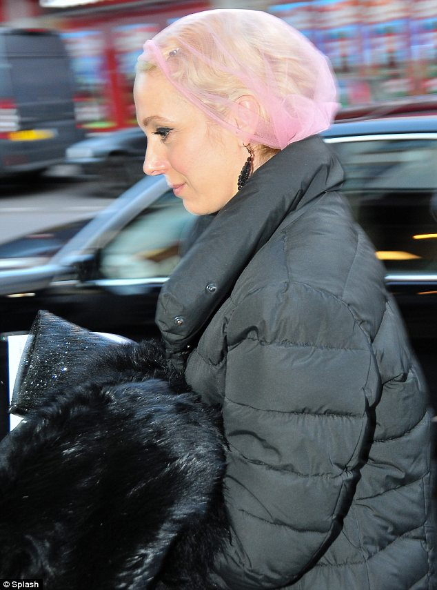 Dressed up! Amanda Abbington arrives at The Daffodil with her hair style in waves and clutching a fur coat