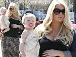 Family day out! Heavily pregnant Jessica Simpson cradles baby Maxwell on her hip after finally setting wedding date to fiance Eric Johnson