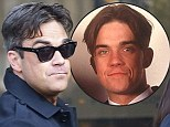 Robbie Williams rolls back the years as he revisits his famous Take That curtains (but this time they're slightly grey!)