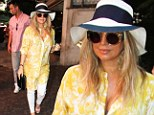 In bloom! Pregnant Fergie wears billowing maternity-style yellow floral shirt as she and husband Josh Duhamel get mobbed by fans in Brazil