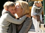 Never let go: Kelly Rutherford and son Hermes hold each other tightly after being thousands of miles apart