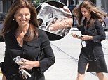 How revealing! Maria Shriver carries custom family photo phone case... but there is no room for Arnold Schwarzenegger