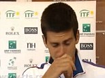 Tears: Novak Djokovic was visibly upset after injuring his ankle against Sam Querrey in the Davis Cup