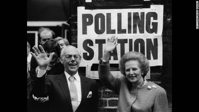 Thatcher and her husband, Denis, wave to the crowd at a London polling station in June 1987. She was re-elected to another term as prime minister that year with a slightly reduced majority.