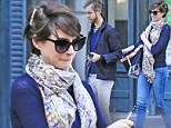 Anne Hathaway and husband Adam Shulman wear coordinated predominantly blue outfits while leaving their apartment in Brooklyn, New York