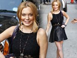 Ready for her close-up! Slender Lindsay Lohan is polished as she rocks her slimmer legs in a leather mini skirt