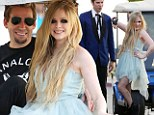 All dolled up! Avril Lavigne is happy to return to work on the set of her new music video...with fiancé Chad Kroeger there to watch