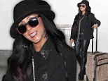 The lady is a vamp! Snooki continues to show off 42-pound weight loss in leather leggings and sky-high platforms