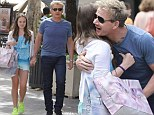 Let's hit the shops: Gordon Ramsay treats middle daughter Holly to the latest fashions at Topshop